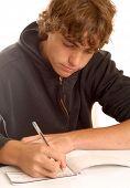 Teenage Boy Writing A Check