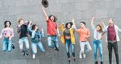 Group Of Young People Jumping Together Outdoor - Happy Millennial Friends Celebrating Success In Col poster