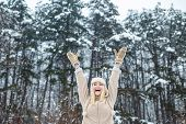 Winter Girl. Happy Woman. Winter Forest Happy Mood. Happy Girl Raised Her Hands Up. Christmas Time. poster