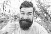 Giving His Barber A Thumbs Up. Happy Barber Gesturing On Natural Landscape. Bearded Man With Shaped  poster