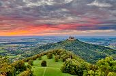 Hilltop Hohenzollern Castle on mountain top at sunset in Swabian Alps, Baden-Wurttemberg, Germany poster