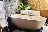 Big Stone Bathtub In A Modern Luxury Villa poster