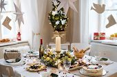 A Table Set For Dinner Meal At Christmas Time. poster