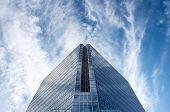 Glass Office Building In Huge Blue Sky