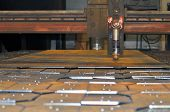 Metal Cutting. Plasma Cutting Of Sheet Metal. Cutter Installation And Cut Parts poster