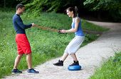 Personal Trainer Working With A Young Woman, Balance Exercise