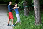 Personal Trainer Working With His Client. Resistance Band Exercise.