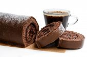 Chocolate  Yule Log Christmas Cake With Cup Of Coffee Isolated On White poster