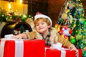 Gift Kid Emotions. New Year Christmas Concept. Happy Kid Having Fun With Big Gift Box. Kid Having Fu poster