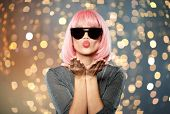 style, fashion and people concept - happy young woman in pink wig and black sunglasses sending air k poster