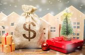 Money Bag, Wooden Houses, Christmas Tree And Gifts. Holiday Discounts. Christmas Sale Of Real Estate poster