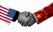 Print Screen Of Usa And China Flag On Shirts Of Businessman Hand Shaking.it Is Symbol Of Economic Ta poster