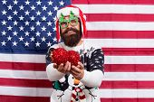 Lets Decorate Xmas Tree. Patriotic Santa Hold Christmas Tree Balls. Bearded American Man With Red Ba poster