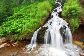 foto of spearfishing  - Beautiful cascading waterfall in the Black Hills National Forest of South Dakota - JPG