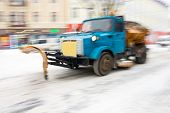 Snow Removal Machine Cleaning The Street From Snow. Snowplow Truck Removing Snow On The Street After poster
