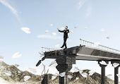 Businessman Walking Blindfolded Among Flying Paper Planes On Concrete Bridge With Huge Gap As Symbol poster
