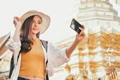 Woman Use Smart Phone To Take Photo. Traveler Tourist Travel On Holiday Vacation. Journey Trip Conce poster