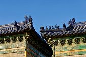 The Roof Of An Ancient Chinese Temple With Blue Ceramic Tiles And Mythical Figures. The Temple Roof  poster