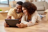 mortgage, people and real estate concept - happy african american couple with tablet pc computer lyi poster