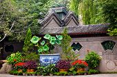 stock photo of ling  - Garden Walls Porcelain Pot Former Residence of Soong Ching - JPG