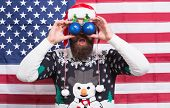 Patriotic Surprise. Surprised Hipster Hold Baubles As Glasses. Bearded Man Look With Surprise. Santa poster