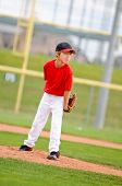 stock photo of little-league  - Little league baseball pitcher on the mound wearing a red jersey - JPG