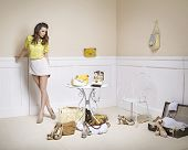 stock photo of erotic  - Elegant lady in a room full of fashion accessories - JPG