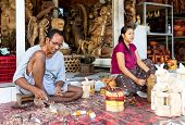 A Man And A Woman Are Making Wooden Crafts