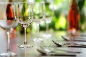 stock photo of champagne glasses  - Restaurant table with cutlery - JPG