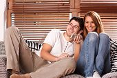 stock photo of watching movie  - young couple watching tv shot with studio lights - JPG