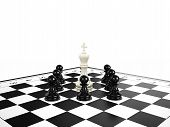stock photo of disadvantage  - White chess king surrounded by black chess pawns on a chessboard 3d render - JPG