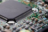 foto of processor socket  - Macro shot of a dirty circuit board