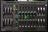 stock photo of supercomputer  - Network Server Rack Panel with hard disks in a data center - JPG