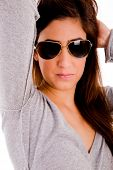 Portrait Of Smiling Model With Sunglasses Holding Her Hair