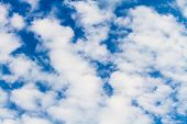 Background Of Fluffy Clouds Against A Blue Sky