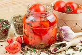 Homemade Tomatoes Preserves In Glass Jar. Canned Tomatoes.