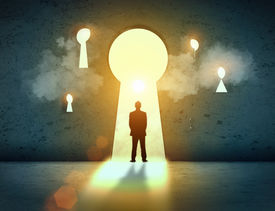 stock photo of keyholes  - Silhouette of businessman standing in keyhole sun shining above - JPG