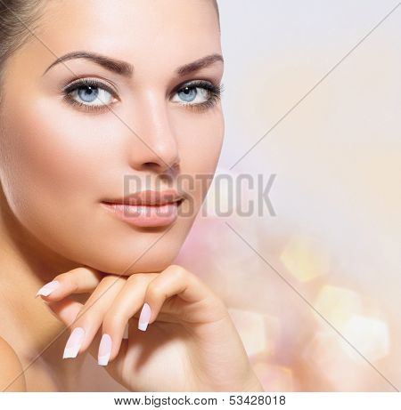 Beauty Portrait. Beautiful Spa Woman Touching her Face. Perfect Fresh Skin closeup. Over Pink Blurre poster