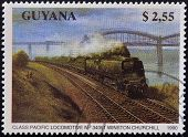 A stamp printed in Guyana shows class pacific locomotive n� 34051 Winston Churchill