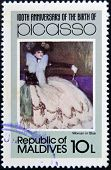 stamp printed in Malldives Islands shows woman in blue by Pablo Ruiz Picasso