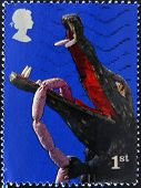 A stamp printed in Great Britain dedicated to Punch and Judy shows crocodile