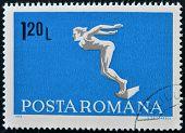 ROMANIA - CIRCA 1969: A stamp printed in Romania shows diving swimmer circa 1969