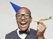 stock photo of blowers  - Mixed race male geek ready to start the party - JPG