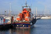 stock photo of outboard engine  - lifeboat moored in Brixham harbour in Torbay - JPG