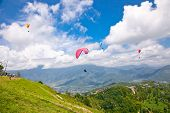 image of parasailing  - Paraglider flying against the Himalayas  - JPG