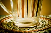 Striped glass mug on mat
