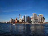 stock photo of freedom tower  - Lower Manhattan NYC including the new One World Trade Center Freedom Tower can be seen across the blue water of the New York Bay at the end of the Hudson River - JPG