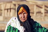 stock photo of nomads  - An old nomad woman in the desert - JPG