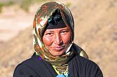 stock photo of sahara desert  - Young nomad woman in the desert - JPG