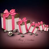 Christmas gift boxes with pink ribbons over dark background. Vector illustration.